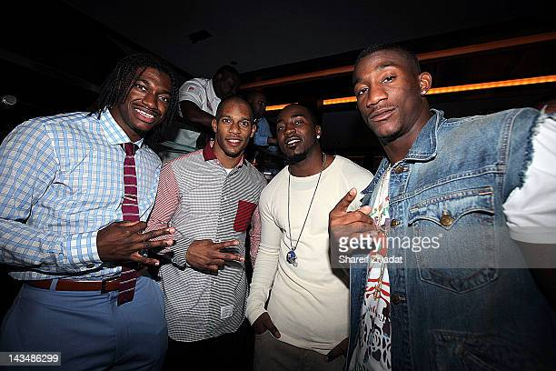 Robert Griffin Victor Cruz and Hakeem Nicks and Antrell Rolle attends the 2012 NFL Draft party at the 40 / 40 Club on April 26 2012 in New York City