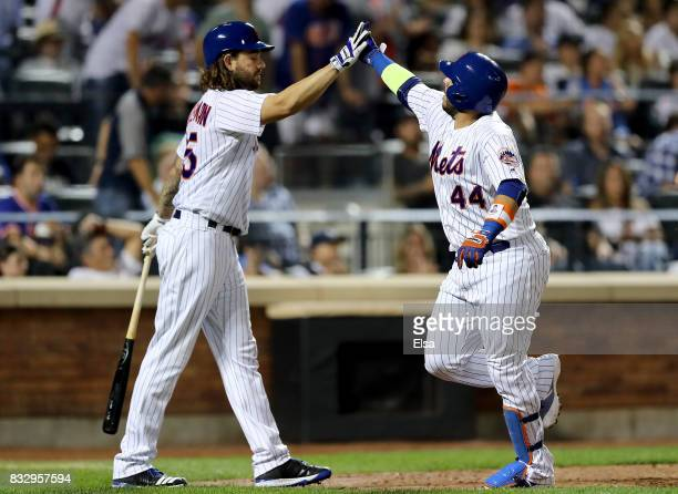 Robert Gsellman of the New York Mets congratulates teammate Rene Rivera after Rivera hit a solo home run in the fifth inning against the New York...