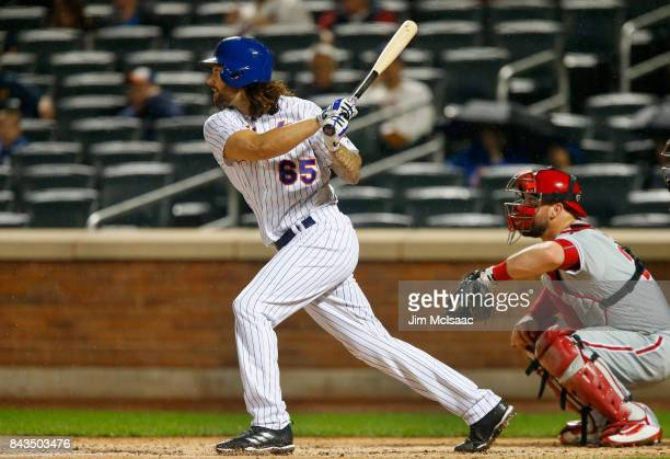 Robert Gsellman of the New York Mets follows through on a second inning RBI single against the Philadelphia Phillies at Citi Field on September 6...