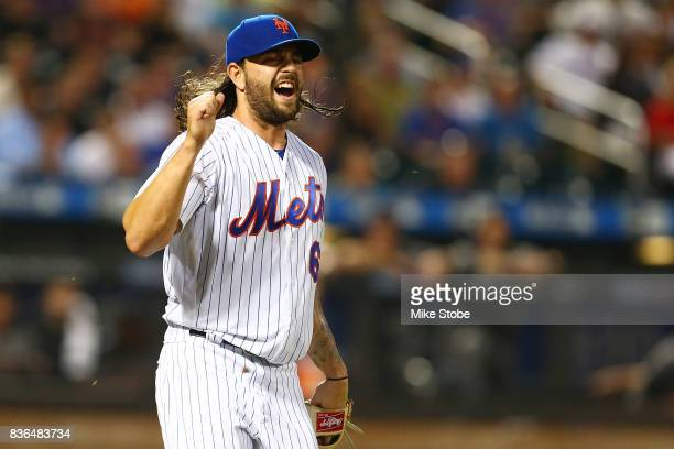 Robert Gsellman of the New York Mets reacts after throwing the ball away for an error in the third inning against the Arizona Diamondbacks at Citi...