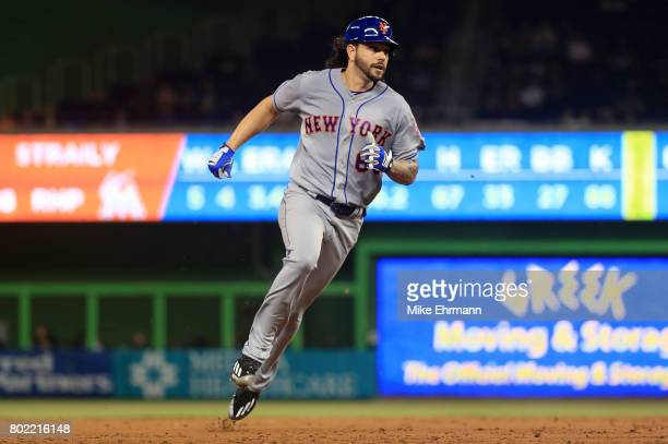 Robert Gsellman of the New York Mets rounds second during a game against the Miami Marlins at Marlins Park on June 27 2017 in Miami Florida
