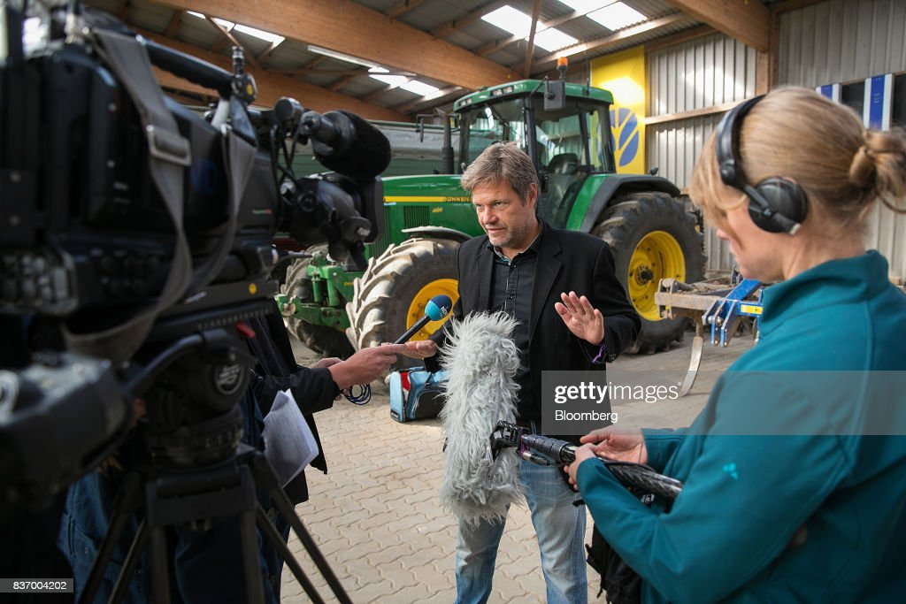 Robert Habeck, candidate for Germanys Green Party, speaks to television journalists during a news conference on a farm ahead of the German elections in Gremmerup, Germany, on Tuesday, Aug. 22, 2017. Germanys diesel scandaland the response to it by Winfried Kretschmann, the Green premier of Baden-Wuerttemberg stateillustrates the kind of politics Germans might expect if the party entered into a government with Chancellor Angela Merkels Christian Democratic Union after the national election on Sept. 24. Photographer: Krisztian Bocsi/Bloomberg via Getty Images