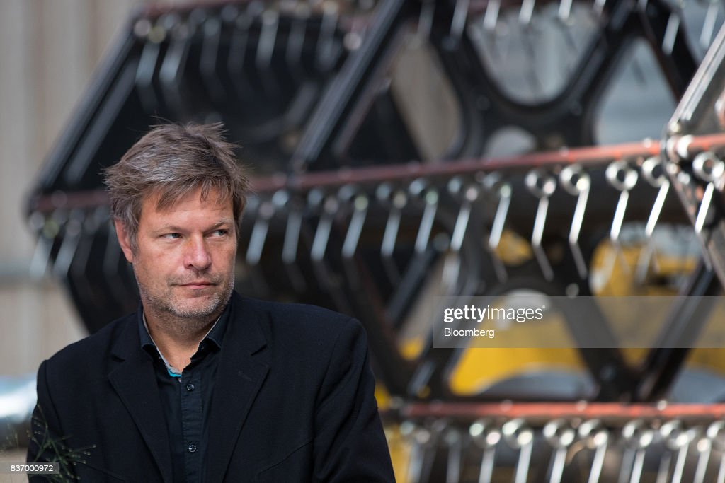 Robert Habeck, candidate for Germanys Green Party, stands in front of a combine harvester's thresher during a news conference on a farm ahead of the German elections in Gremmerup, Germany, on Tuesday, Aug. 22, 2017. Germanys diesel scandaland the response to it by Winfried Kretschmann, the Green premier of Baden-Wuerttemberg stateillustrates the kind of politics Germans might expect if the party entered into a government with Chancellor Angela Merkels Christian Democratic Union after the national election on Sept. 24. Photographer: Krisztian Bocsi/Bloomberg via Getty Images