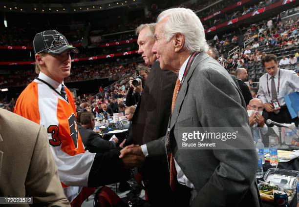 Robert Hagg drafted overall by the Philadelphia Flyers greets Flyers team owner Ed Snider after he was picked in the second round during the 2013 NHL...