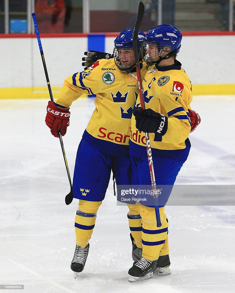 Robert Hagg #4 of Sweden celebrates his third period goal with teammate <a gi-track='captionPersonalityLinkClicked' href=/galleries/search?phrase=Anton+Karlsson+-+Ice+Hockey+Winger&family=editorial&specificpeople=15436236 ng-click='$event.stopPropagation()'>Anton Karlsson</a> #28 against team USA during the U-18 Four Nations Cup tounament on November 9, 2012 at the Ann Arbor Ice Cube in Ann Arbor, Michigan. USA won 5-3.