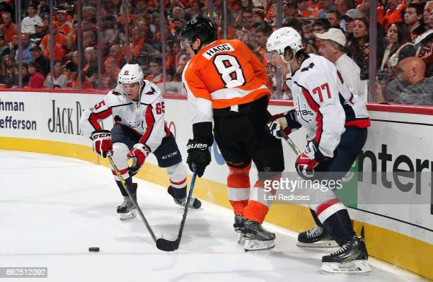 Robert Hagg of the Philadelphia Flyers battles for the puck against TJ Oshie and Andre Burakovsky of the Washington Capitals on October 14 2017 at...