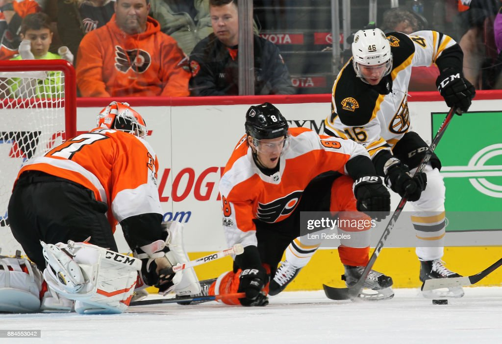 Robert Hagg #8 of the Philadelphia Flyers defends goaltender Brian Elliott #37 against David Krejci #46 of the Boston Bruins as they battle for the loose puck on December 2, 2017 at the Wells Fargo Center in Philadelphia, Pennsylvania. The Bruins went on to defeat the Flyers 3-0.