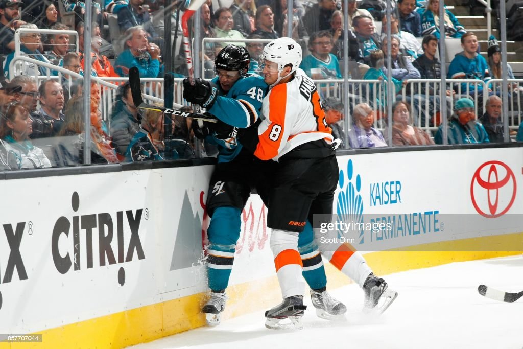 Robert Hagg #8 of the Philadelphia Flyers hits Tomas Hertl #48 of the San Jose Sharks during a NHL game at SAP Center at San Jose on October 4, 2017 in San Jose, California.