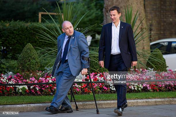 Robert Halfon deputy chairman of the Conservative Party and Jeremy Hunt Secretary of State for Health arrive at Downing Street on June 30 2015 in...