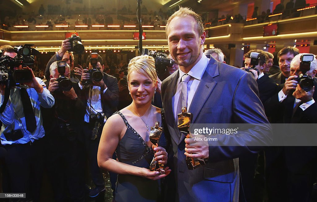 <a gi-track='captionPersonalityLinkClicked' href=/galleries/search?phrase=Robert+Harting&family=editorial&specificpeople=4454412 ng-click='$event.stopPropagation()'>Robert Harting</a> and <a gi-track='captionPersonalityLinkClicked' href=/galleries/search?phrase=Magdalena+Neuner&family=editorial&specificpeople=2095093 ng-click='$event.stopPropagation()'>Magdalena Neuner</a> pose after being awarded Germany's male and female 'Athlete of the Year 2012' during a gala at the Kurhaus Baden-Baden on December 16, 2012 in Baden-Baden, Germany.