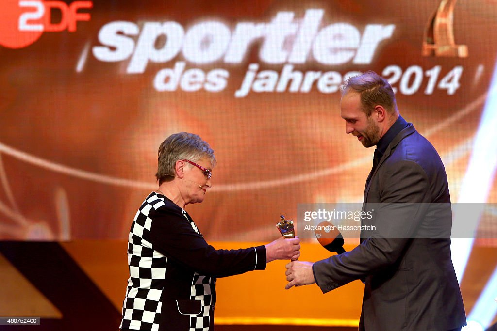 <a gi-track='captionPersonalityLinkClicked' href=/galleries/search?phrase=Robert+Harting&family=editorial&specificpeople=4454412 ng-click='$event.stopPropagation()'>Robert Harting</a> is awarded as Sportsmen of the Year by his grandmother Renate Seidel during the Sportler des Jahres 2014 (German Athlete of the Year) gala at the Kurhaus Baden-Baden on December 21, 2014 in Baden-Baden, Germany.