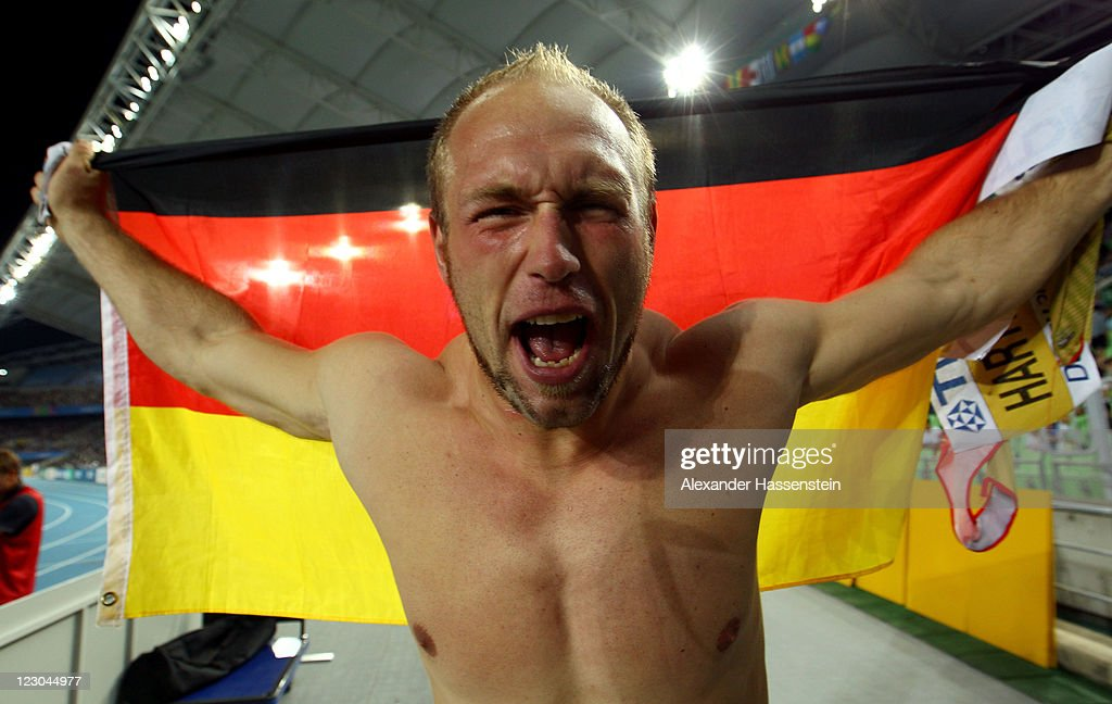 <a gi-track='captionPersonalityLinkClicked' href=/galleries/search?phrase=Robert+Harting&family=editorial&specificpeople=4454412 ng-click='$event.stopPropagation()'>Robert Harting</a> of Germany celebrates as he wins gold in the men's discus throw final during day four of 13th IAAF World Athletics Championships at Daegu Stadium on August 30, 2011 in Daegu, South Korea.