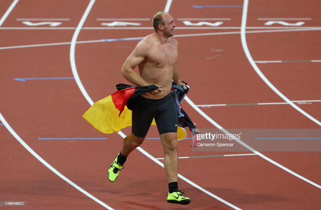 <a gi-track='captionPersonalityLinkClicked' href=/galleries/search?phrase=Robert+Harting&family=editorial&specificpeople=4454412 ng-click='$event.stopPropagation()'>Robert Harting</a> of Germany celebrates winning gold in the Men's Discus Throw Final on Day 11 of the London 2012 Olympic Games at Olympic Stadium on August 7, 2012 in London, England.