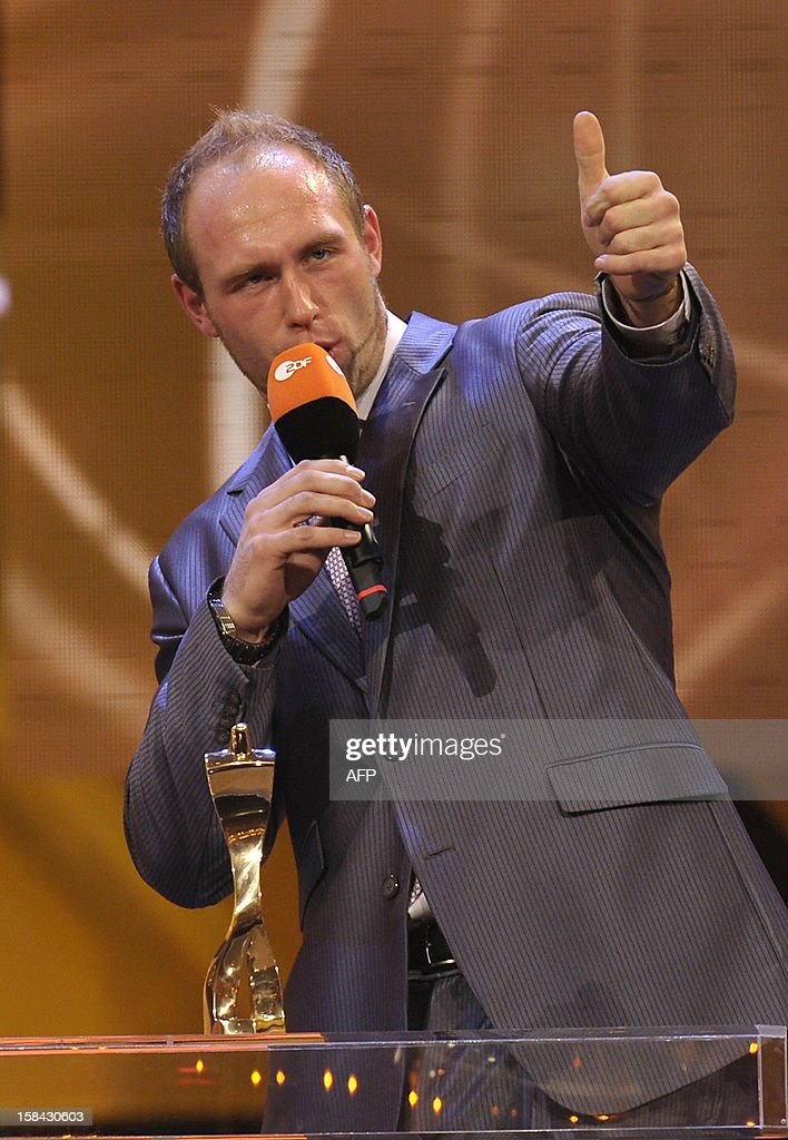 Robert Harting, Olympic discus gold medalist, gives the thumbs-up after being awarded Germany's Athlete of the Year 2012 in Baden-Baden, southwestern Germany, on December 16, 2012.