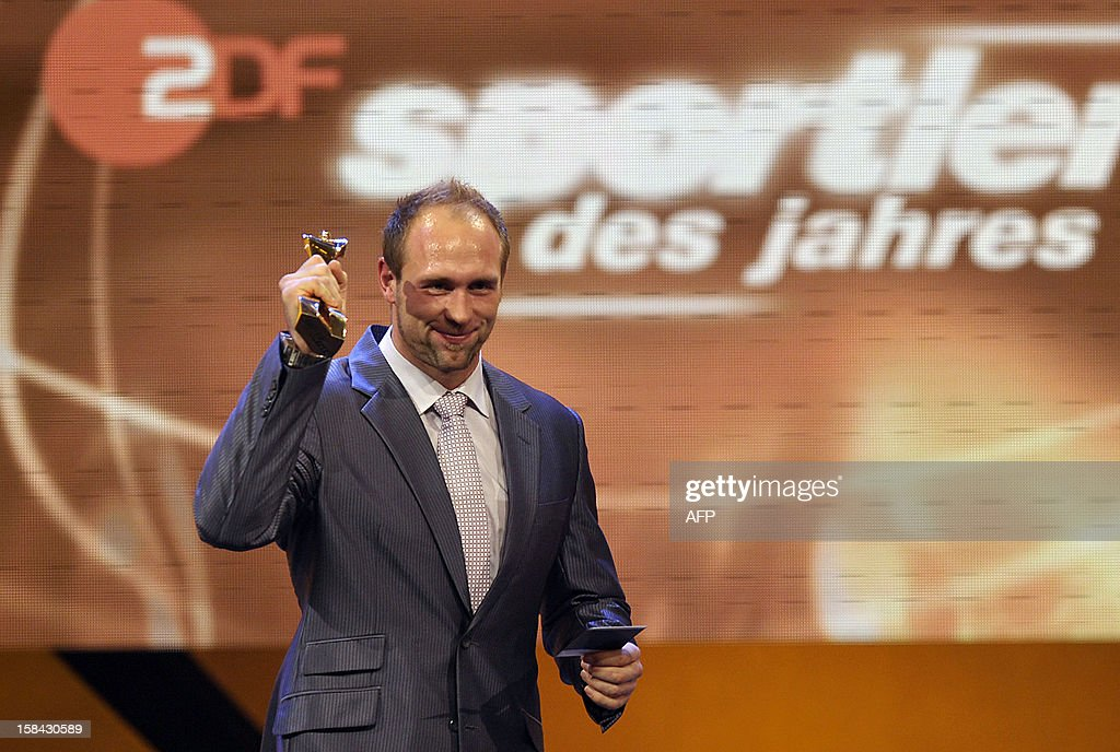Robert Harting, Olympic discus gold medalist, holds up the trophy after being awarded Germany's Athlete of the Year 2012 in Baden-Baden, southwestern Germany, on December 16, 2012.