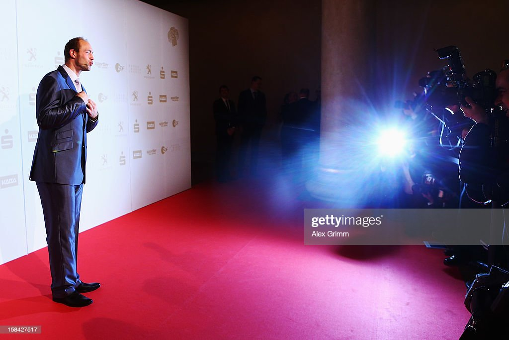 <a gi-track='captionPersonalityLinkClicked' href=/galleries/search?phrase=Robert+Harting&family=editorial&specificpeople=4454412 ng-click='$event.stopPropagation()'>Robert Harting</a> poses for the 'Athlete of the Year 2012' gala at the Kurhaus Baden-Baden on December 16, 2012 in Baden-Baden, Germany.