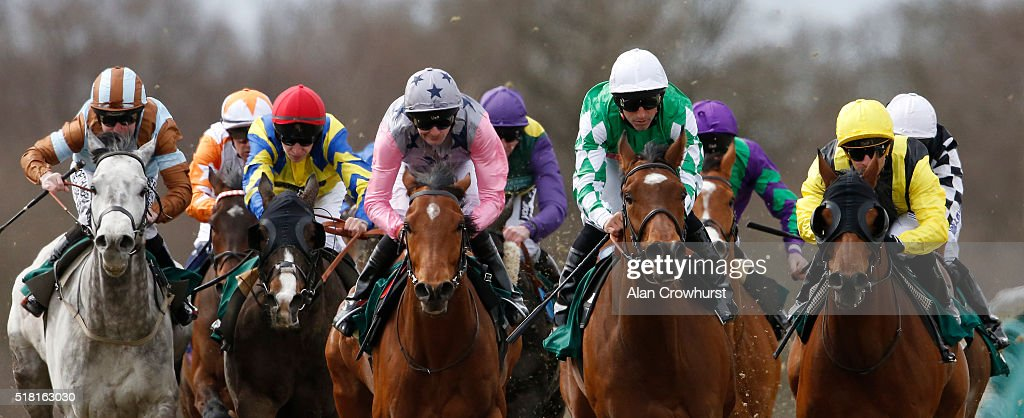 Robert Havlin riding Knight Music (C, pink sleeves) on their way to winning Thebestbettingsites.co.uk UKS Top Betting Site Offers Handicap Stakes at Lingfield racecourse on March 30, 2016 in Lingfield, England.