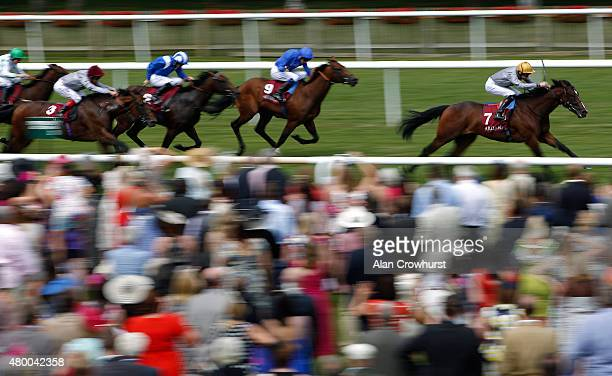 Robert Havlin riding Shalaa win The Arqana July Stakes at Newmarket racecourse on July 09 2015 in Newmarket England