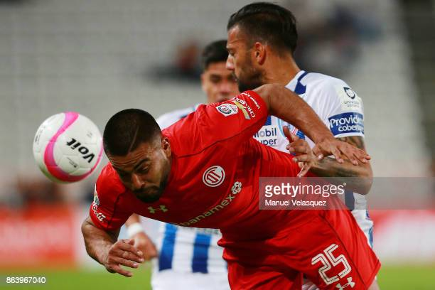 Robert Herrera of Pachuca struggles for the ball against Pedro Canelo of Pachuca during the 10th round match between Pachuca and Toluca as part of...
