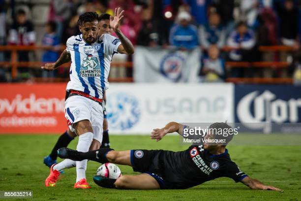Robert Herrera of Pachuca struggles for the ball with Francisco Silva of Cruz Azul during the 11th round match between Pachuca and Cruz Azul as part...