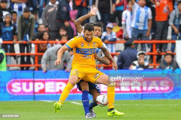 Robert Herrera of Pachuca vies for the ball with Andre Gignac of Tigres during their Mexican Apertura 2017 Tournament football match at Hidalgo...