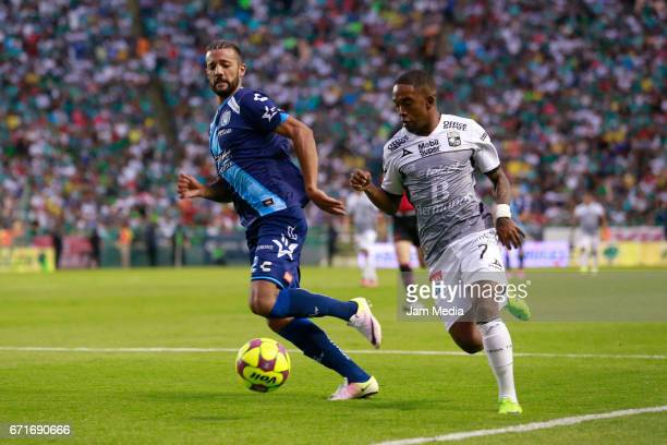 Robert Herrera of Puebla and Hernan Burbano of Leon fight for the ball during the 15th round match between Leon and Puebla as part of the Torneo...