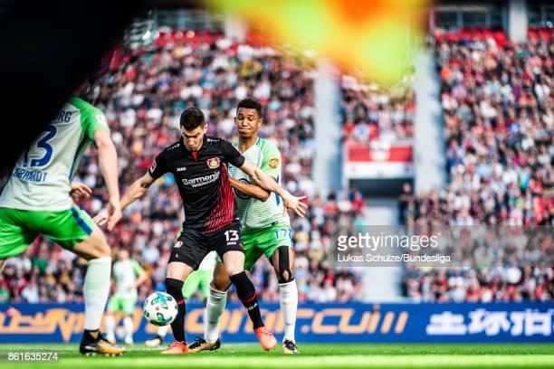 Robert Hilbert of Leverkusen and Felix Uduokhai of Wolfsburg in action during the Bundesliga match between Bayer 04 Leverkusen and VfL Wolfsburg at...