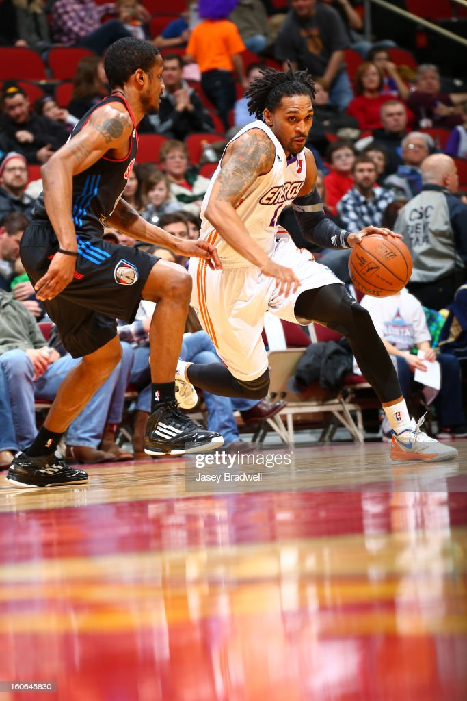 Robert Hite #13 of the Iowa Energy drives past the Springfield Armor in an NBA D-League game on February 2, 2013 at the Wells Fargo Arena in Des Moines, Iowa.