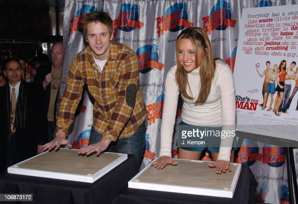 Robert Hoffman and Amanda Bynes during Dreamworks And Planet Hollywood Present 'She's The Man' Handprint Ceremony February 24 2006 at Planet...