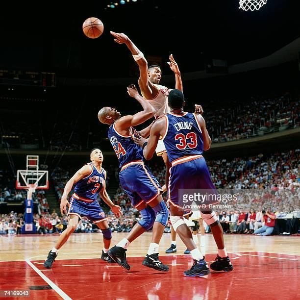 Robert Horry of the Houston Rockets passes against Patrick Ewing of the New York Knicks during Game One of the NBA Finals played on June 8 1994 at...