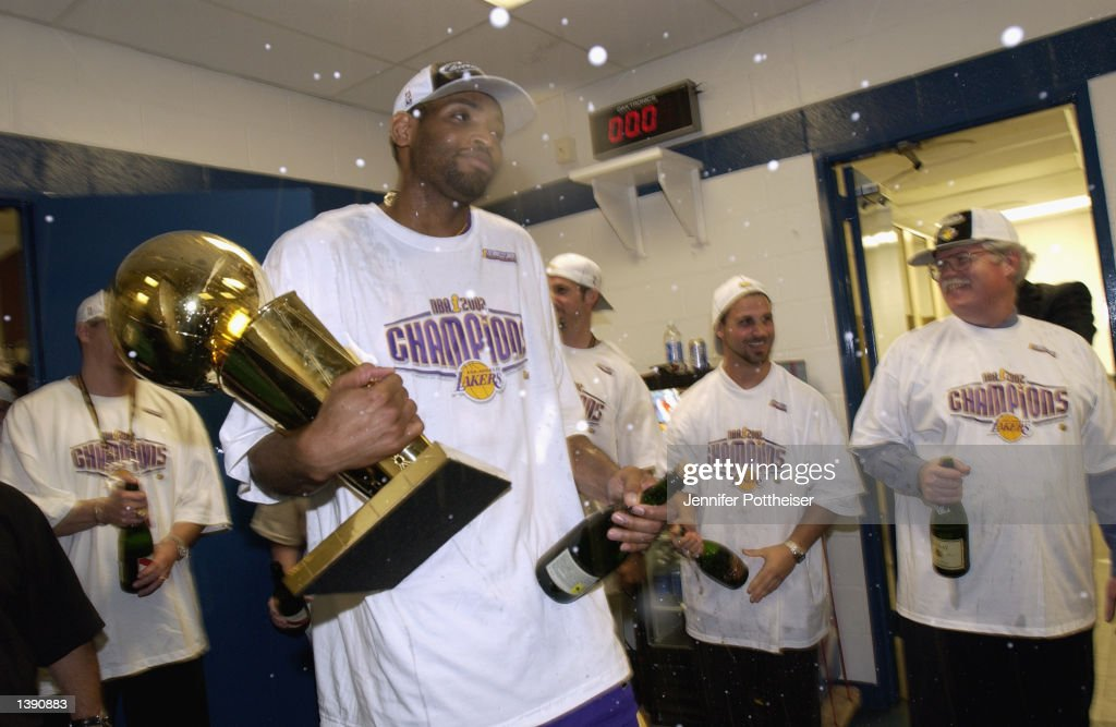 b34906132bd ... Robert Horry 5 of the Los Angeles Lakers celebrates with the 2002 NBA  Championship Trophy ...