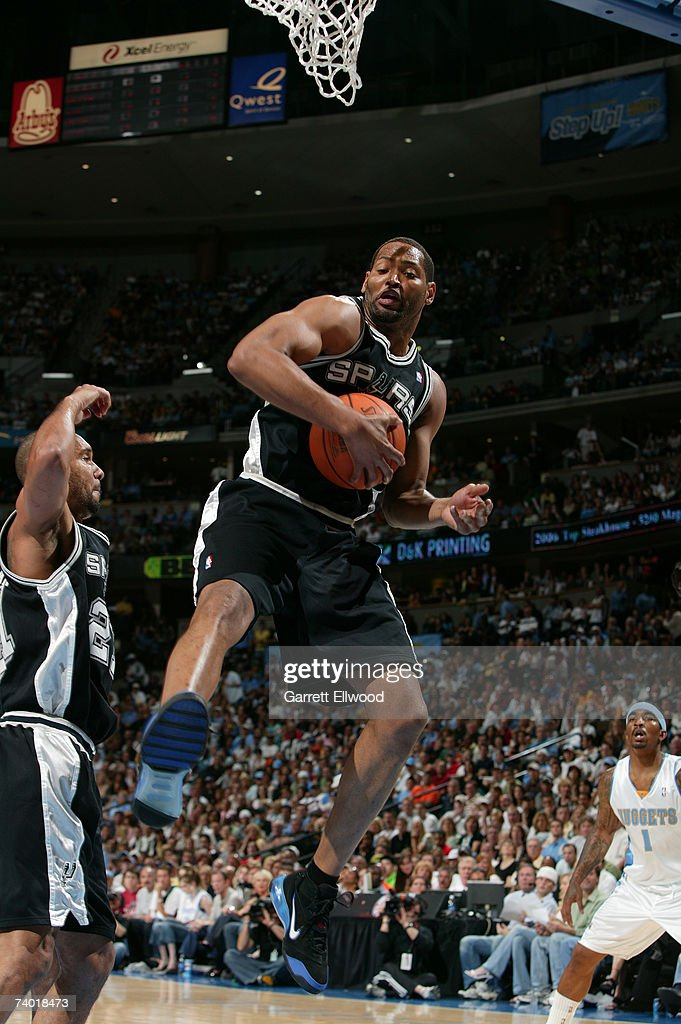 Robert Horry #5 of the San Antonio Spurs grabs a rebound against the Denver Nuggets in Game Three of the Western Conference Quarterfinals during the 2007 NBA Playoffs at Pepsi Center on April 28, 2007 in Denver, Colorado.