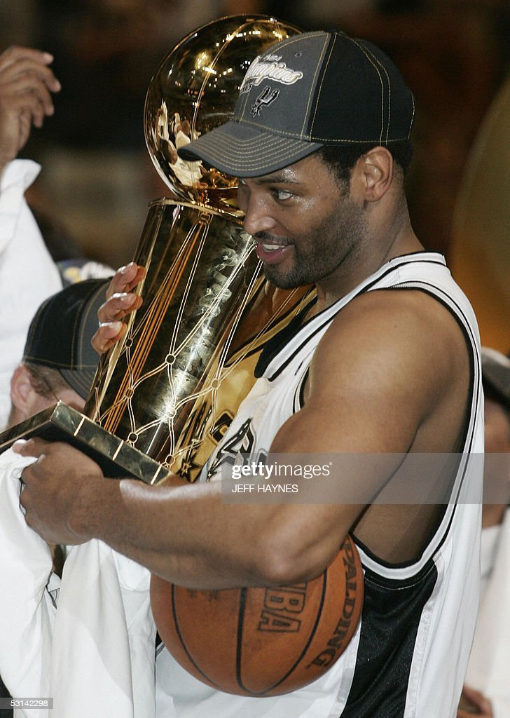 Robert Horry of the San Antonio Spurs holds The Larry O'Brien NBA Championship Trophy after beating the Detroit Pistons in the NBA Finals game seven 23 June, 2005 at the SBC Center in San Antonio, Texas. The Spurs won the game 81-74 to win the seven game series 4-3. Horry has six championships with three different teams.