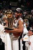 Robert Horry of the San Antonio Spurs holds the Larry O'Brien Championship trophy following the Spurs 8174 win against the Detroit Pistons in Game...