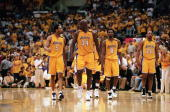 Robert Horry Shaquille O'Neal Kobe Bryant and Brian Shaw of the Los Angeles Lakers walk on the court during Game 7 of the Western Conference Finals...