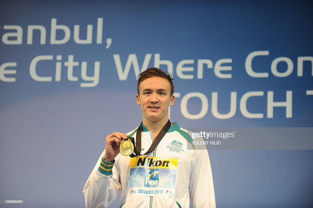 Robert Hurley of Australia celebrates with his gold medal during the podium ceremony for the Men's 50m backstroke during the FINA World Short Course Swimming Championships in Istanbul on December 15, 2012.
