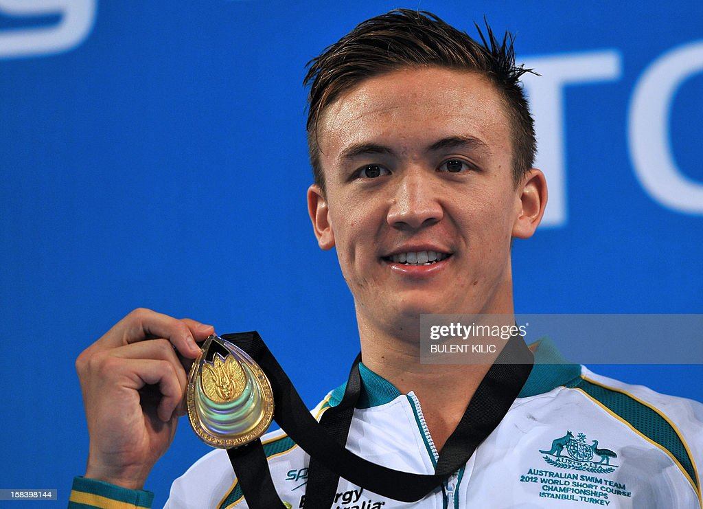 Robert Hurley of Australia smiles on the podium after winning the men's 50m backstroke final during the FINA World Short Course Swimming Championships in Istanbul on December 15, 2012.