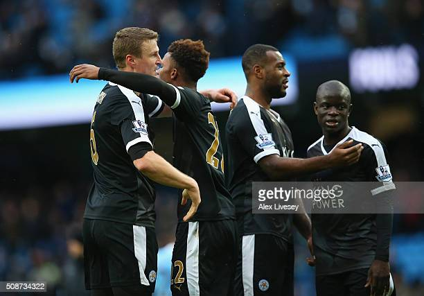 Robert Huth Demarai Gray Wes Morgan and Ngolo Kante of Leicester City celebrate their 31 win in the Barclays Premier League match between Manchester...