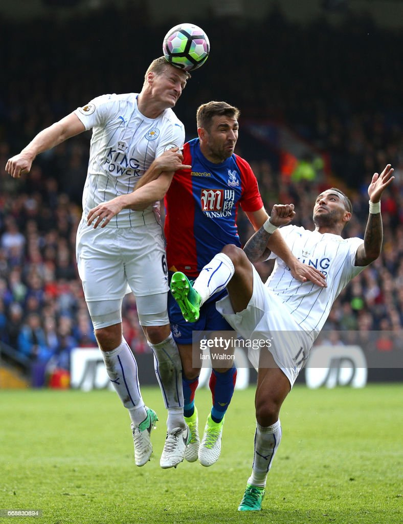 Robert Huth of Leicester City and Luka Milivojevic of Crystal Palace battle to win a header during the Premier League match between Crystal Palace and Leicester City at Selhurst Park on April 15, 2017 in London, England.