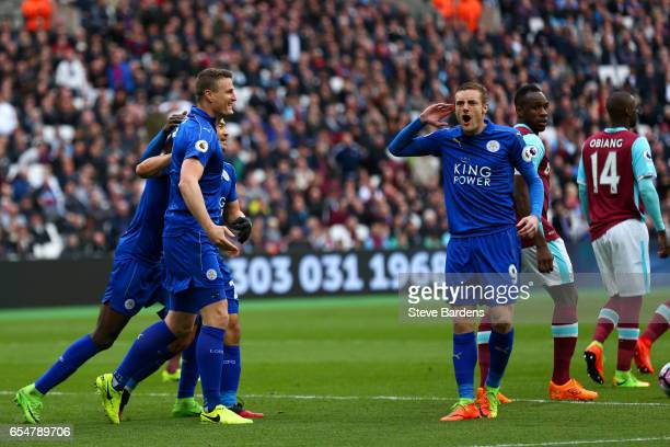 Robert Huth of Leicester City celebrates scoring his sides second goal with Jamie Vardy of Leicester City during the Premier League match between...