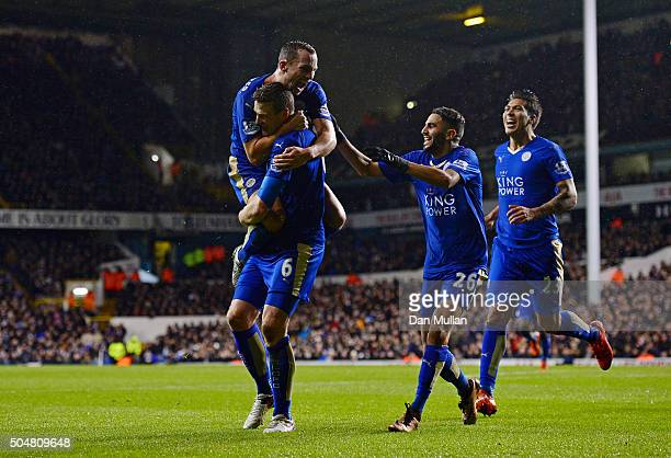 Robert Huth of Leicester City celebrates scoring his team's first goal with his team mates Danny Drinkwater Riyad Mahrez and Leonardo Ulloa of...