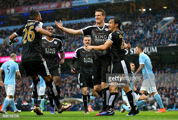 Robert Huth of Leicester City celebrates scoring his team's first goal with his team mate Shinji Okazaki and Riyad Mahrez during the Barclays Premier...