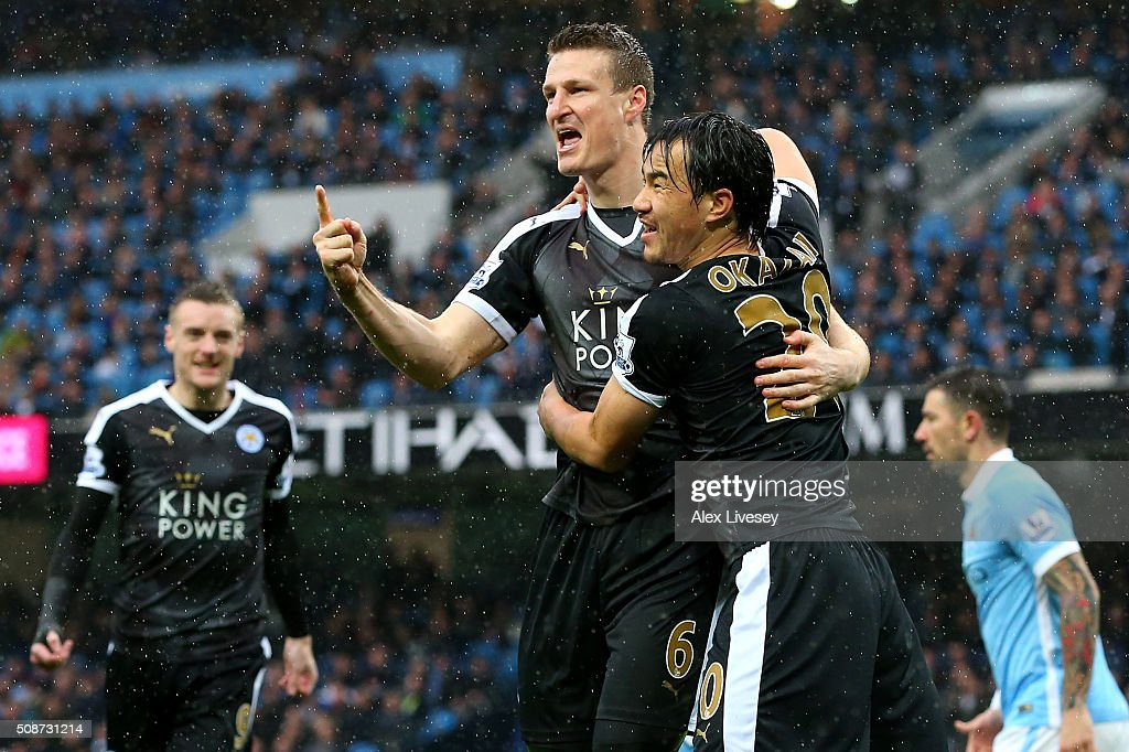 <a gi-track='captionPersonalityLinkClicked' href=/galleries/search?phrase=Robert+Huth&family=editorial&specificpeople=206878 ng-click='$event.stopPropagation()'>Robert Huth</a> (L) of Leicester City celebrates scoring his team's first goal with his team mate <a gi-track='captionPersonalityLinkClicked' href=/galleries/search?phrase=Shinji+Okazaki&family=editorial&specificpeople=4320771 ng-click='$event.stopPropagation()'>Shinji Okazaki</a> (R) during the Barclays Premier League match between Manchester City and Leicester City at the Etihad Stadium on February 6, 2016 in Manchester, England.