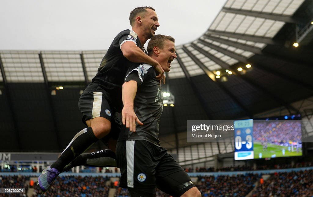 <a gi-track='captionPersonalityLinkClicked' href=/galleries/search?phrase=Robert+Huth&family=editorial&specificpeople=206878 ng-click='$event.stopPropagation()'>Robert Huth</a> (R) of Leicester City celebrates scoring his team's third goal with his team mate <a gi-track='captionPersonalityLinkClicked' href=/galleries/search?phrase=Danny+Drinkwater&family=editorial&specificpeople=4224396 ng-click='$event.stopPropagation()'>Danny Drinkwater</a> (L) during the Barclays Premier League match between Manchester City and Leicester City at the Etihad Stadium on February 6, 2016 in Manchester, England.