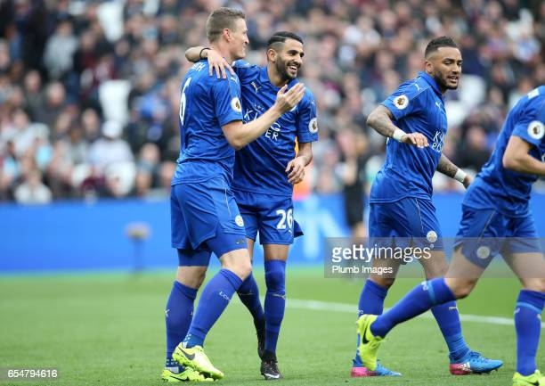 Robert Huth of Leicester City celebrates with Riyad Mahrez of Leicester City after scoring to make it 02 during the Premier League match between West...