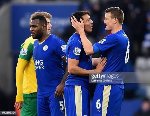 Robert Huth of Leicester City congratulates Leonardo Ulloa on his match winning goal during the Barclays Premier League match between Leicester City...