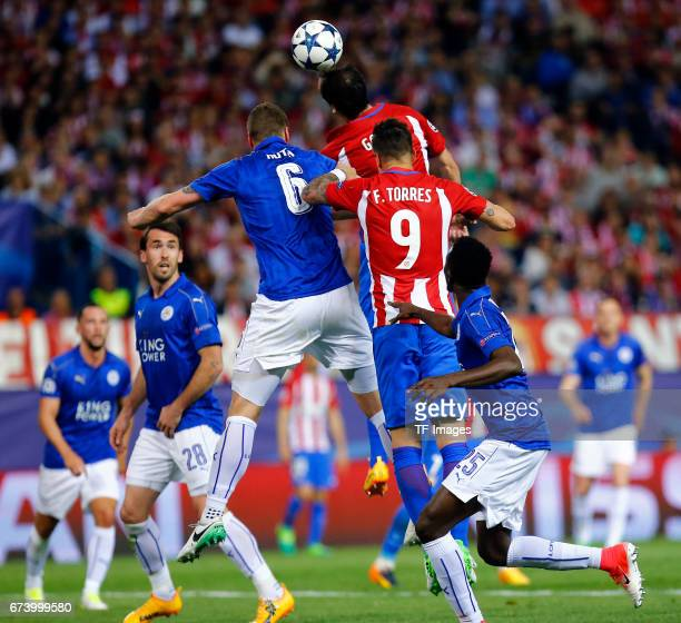 Robert Huth of Leicester City Gabi of Atletico Madrid and Fernando Torres of Atletico Madrid battle for the ball during the UEFA Champions League...