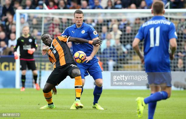 Robert Huth of Leicester City in action with Oumar Niasse of Hull City during the Premier League match between Leicester City and Hull City at King...