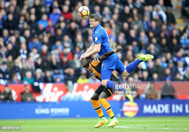 Robert Huth of Leicester City in action with Our Niasse of Hull City during the Premier League match between Leicester City and Hull City at King...