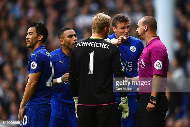 Robert Huth of Leicester City protests to referee Robert Madley against his penalty dicision during the Premier League match between Tottenham...